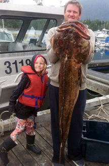 Brett Grimm and his daughter Hana. With their 55lbs Lingcod