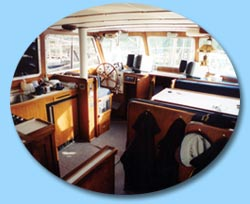 There is an aft cabin with two double bunks and a head with vanity and shower.